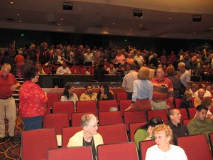The audience during intermission. The control booth is in the center just beyond Dennis who is in the aisle with a red shirt.