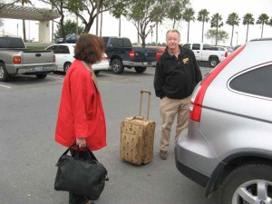 Karen arrives at the Miller-McAllen Airport and Dennis puts her suitcase in our car.