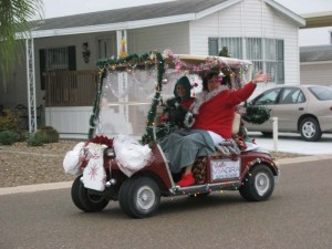 Theresa gives Nancy a ride in the parade. Nancy looks like an elf. Theresa's golf cart got third prize.