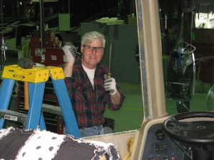 Stan kids around when I take his photo. He's replacing the driver side window. Stan's son, Scotty, works in Parts.