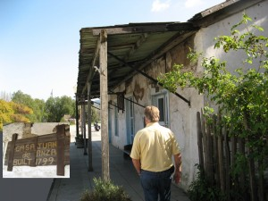 Dennis walks by a very old structure, Casa Juan de Anza, built in 1799. The inset shows the sign on the wall ahead of Dennis.