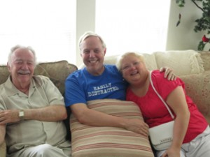 This is a family of gigglers, Uncle Dennis with his nephew and niece, Kevin and Jana.