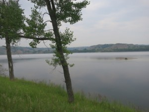 Missouri River below Garrison Dam flows by Downstream Campground, Riverdale, ND.